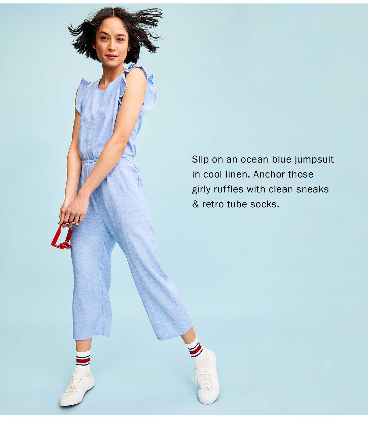 Slip on an ocean-blue jumpsuit in cool linen. Anchor those girly ruffles with clean sneaks & retro tube socks.